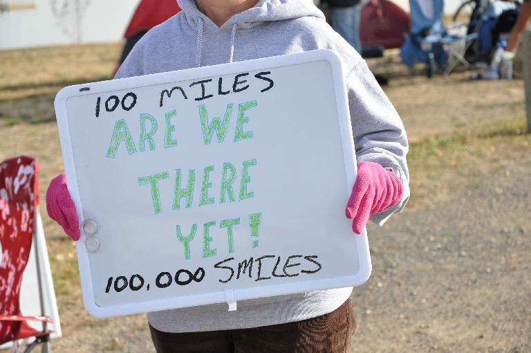 "[Mile 93, 9:40a] ""100 miles, are we there yet!""  Not sure about the 100,000 smiles. Photo: Eddie Metro."