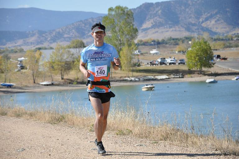 [Mile 15, 11:59a] Running by the Boulder Reservoir, still feeling fresh. Photo: Eddie Metro.