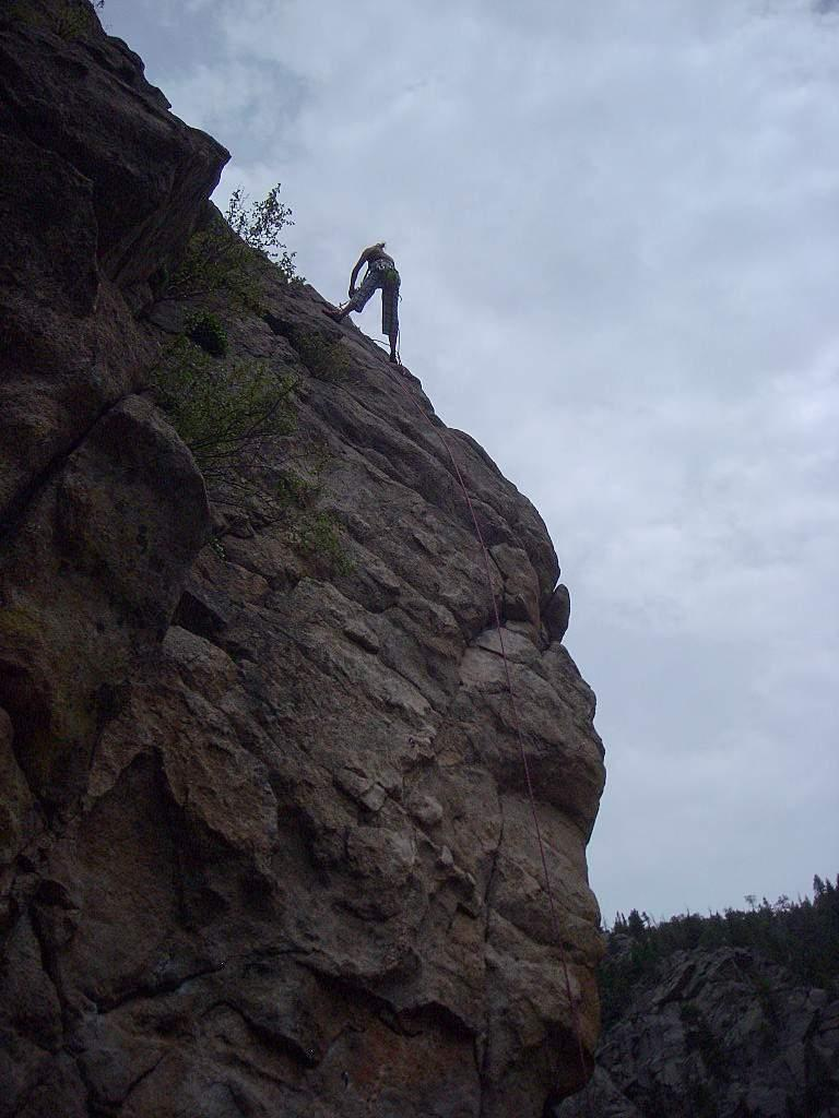 Anita rappelling off Qs (5.9+) after successfully climbing it on toprope.