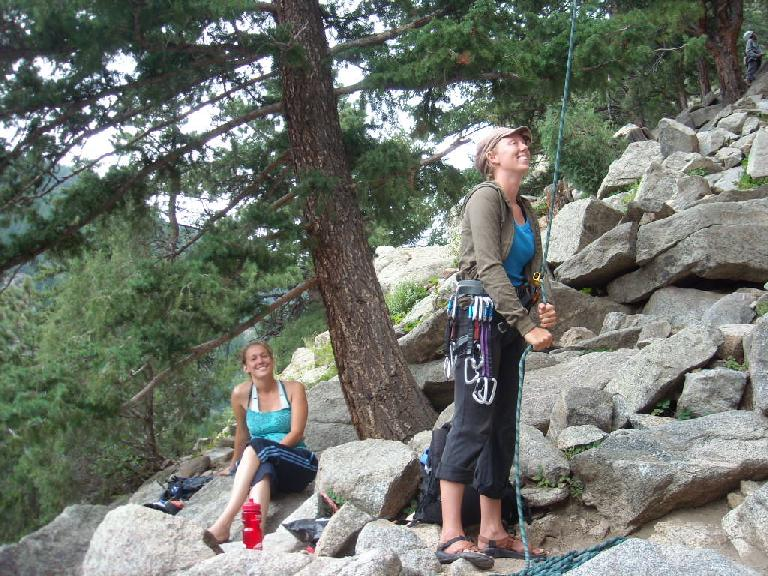 Anita on belay with Isabel looking on.