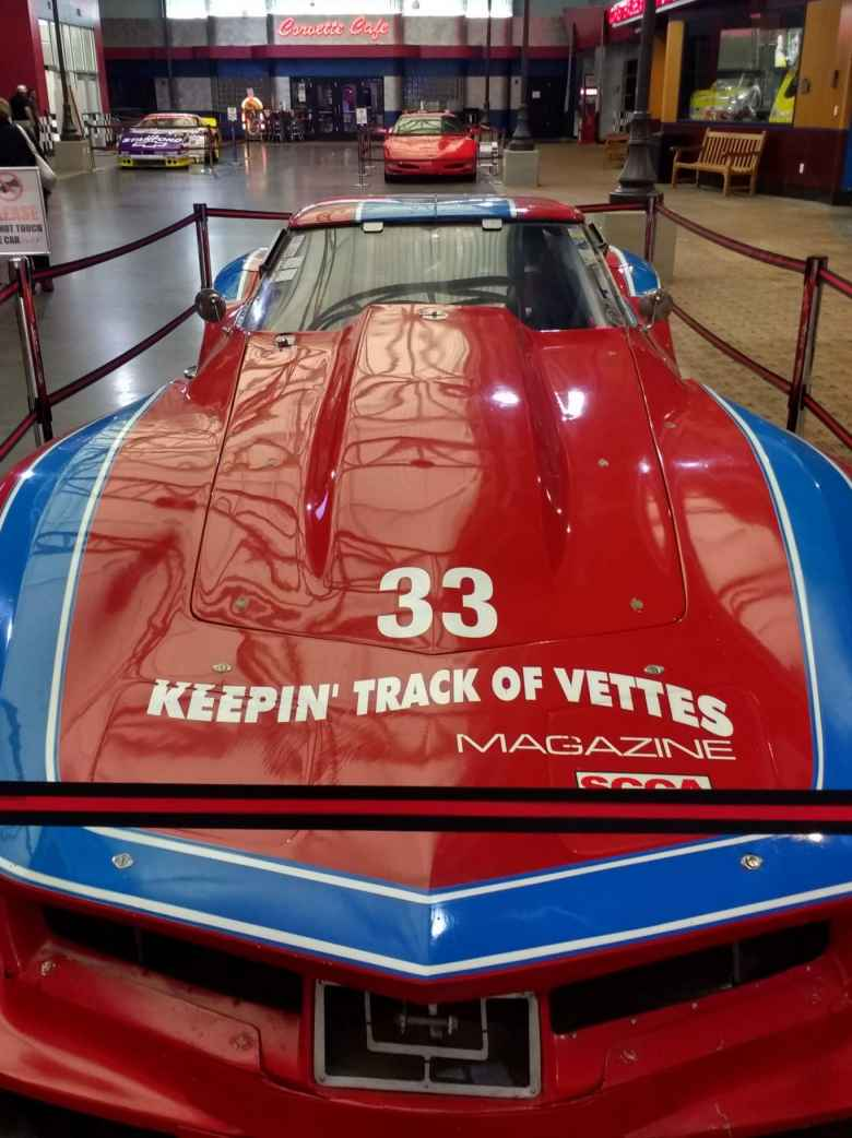 A red and blue C3 Corvette race car, with race number 33 and Keepin'Track of Vettes Magazine decal, at the National Corvette Museum in Bowling Green, Kentucky.