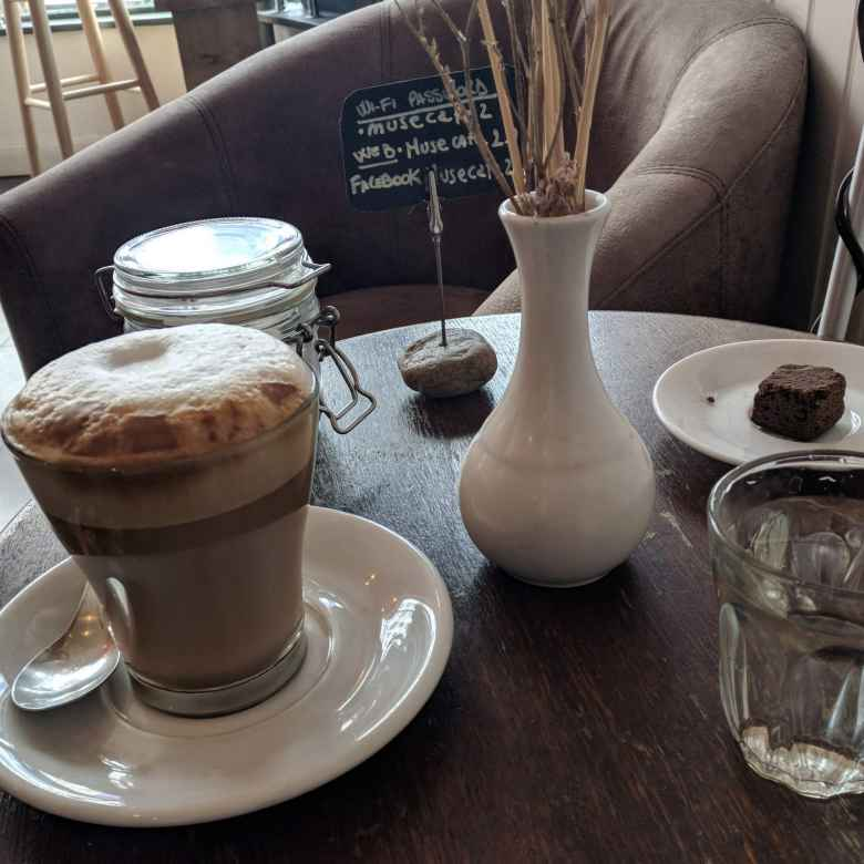 The barista at the Muse Café in Brighton and Cove brought me a glass of water, chocolate morsel, and wi-fi code along with a latte when I ordered the coffee. Really good service!