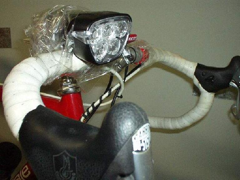 During the 2003 Davis 400k Brevet, my home-made light bracket snapped in half.  Fortunately, I was just a mile from a store where I bought a whole roll of packaging tape, and taped the light to my handlebars (and ride until 2:00am!) (April 19, 2003)