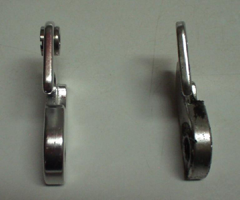 More detail on the Griffen's replaceable rear derailleur hanger.  The one on the left is a new one; the one on the right is the bent one. (July 17, 2004)