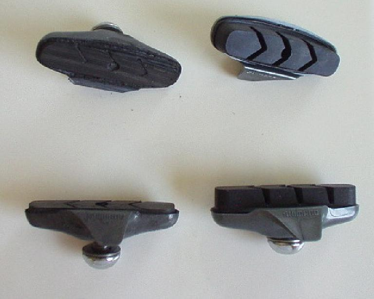 After just 1.5 years my rear brake pads were hosed, especially after riding through the wet roads of the Butterfield Double.  Look at how worn through they were (left) compared to the new ones on the right! (June 3, 2005)