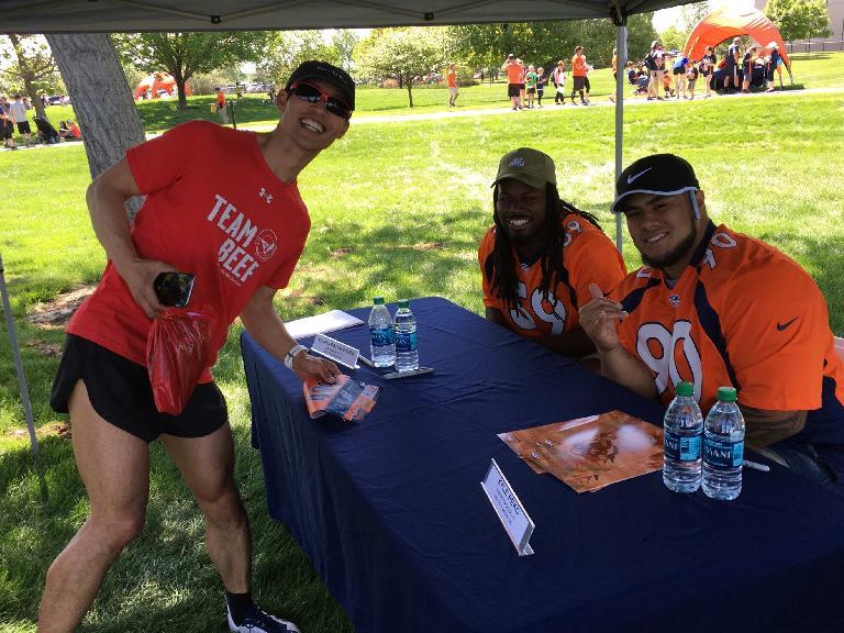 Felix Wong with Denver Broncos linebacker Vontarrius Dora and nose tackle Kyle Peko.