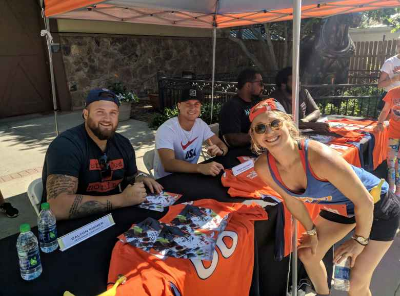 Broncos Dalton Risner and River Cracraft with Emily.
