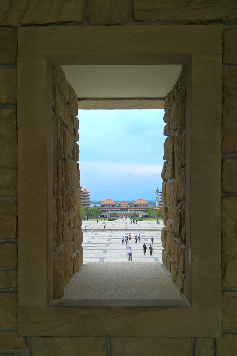Buildings at the Buddha Memorial Center in Taiwan as viewed through a window.