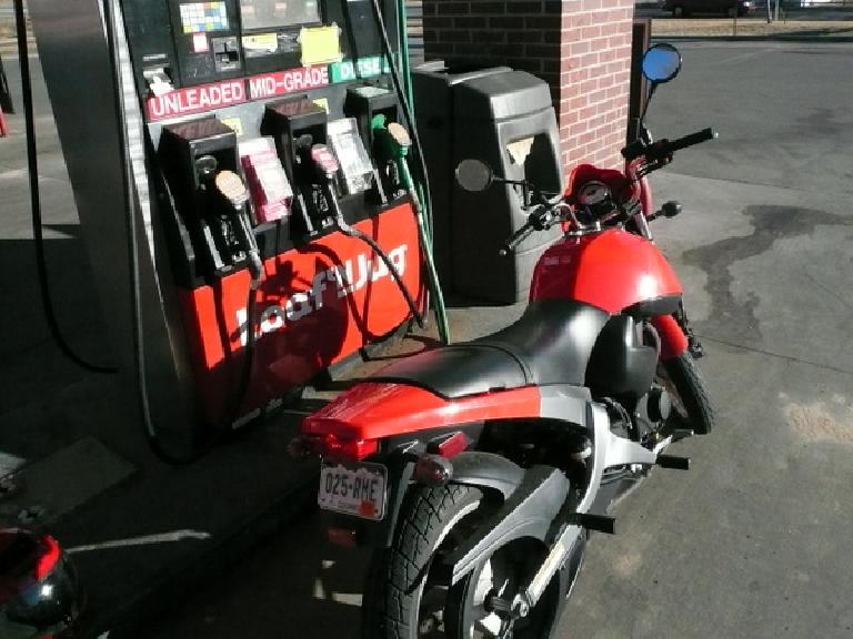 Filling up my Buell Blast with gas.