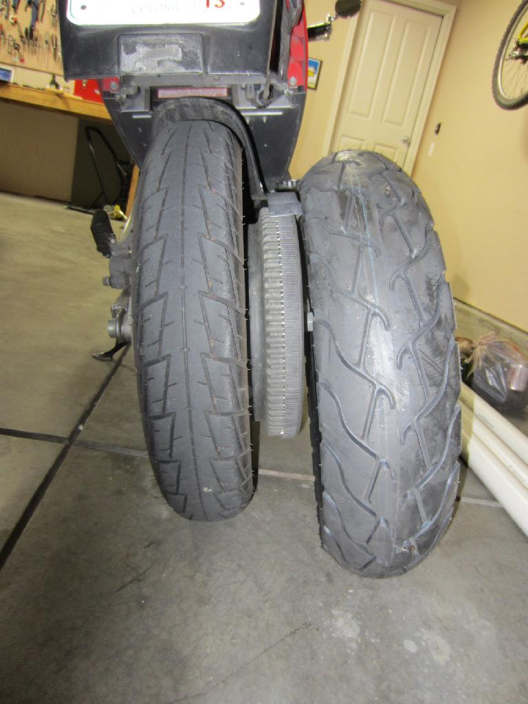 "The Pirelli ST66 140/70-16 (left) is about 1"" wider than the stock Dunlop K330 120/80-16. (May 12, 2012)"