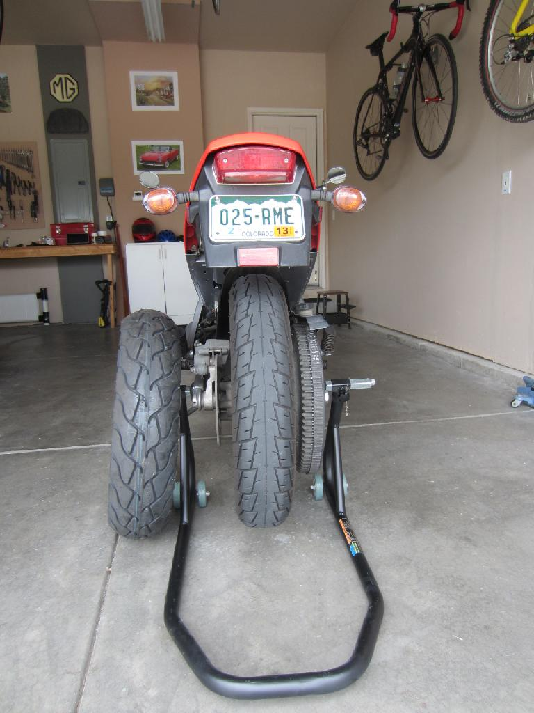 I removed the rear wheel myself and brought it in with the new tire to be installed at a local motorcycle shop for $30. (July 12, 2012)