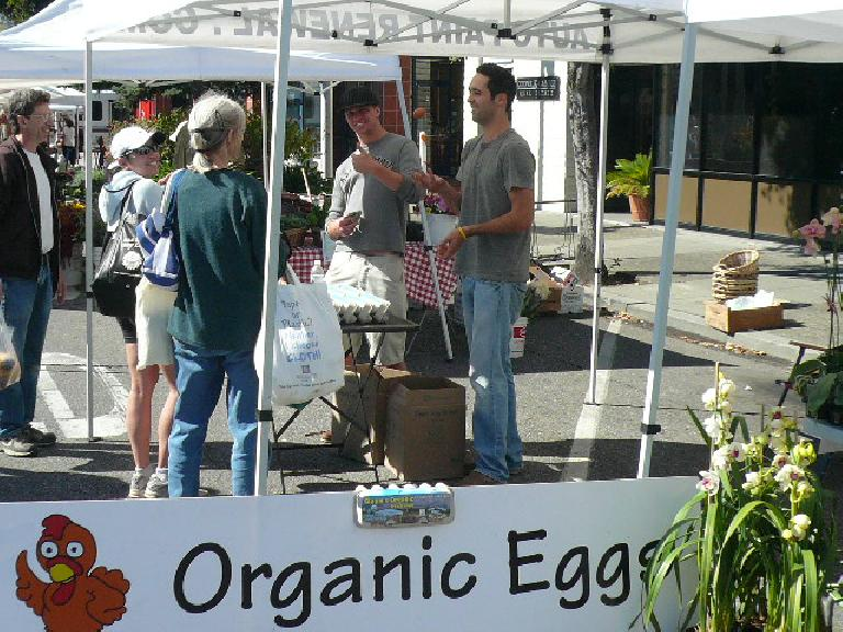 "Dude juggling organic eggs.  Motto: ""Happy chickens = happy eggs!"""