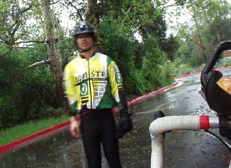 [Mile 26, 6:51am] Felix Wong at the first checkpoint, fairly comfortable despite being drenched in several torrential downpours already.