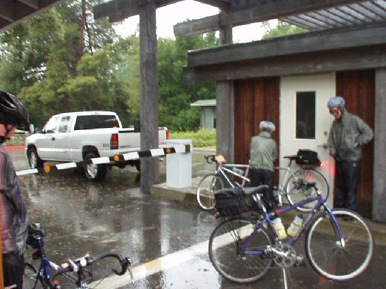 [Mile 26, 6:59 a.m.] Other riders at the first checkpoint, standing out of the rain wondering what I was thinking: is Planet Ultra going to arrive with some food?