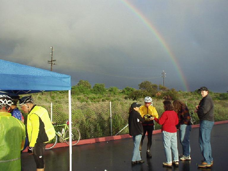 [Mile 133, 4:59 p.m.] Nice rainbow near Camp Pendleton at this makeshift checkpoint where the SAG vehicle only had just arrived with everyone's lights (well after most people had come through already).  Yikes, I was glad I kept my lights with me.