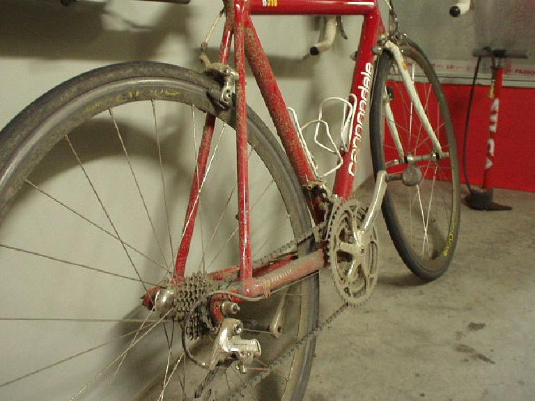 My poor Cannondale back in the Garage Mahal the next day, just totally thrashed.  You can see the gear the rear derailleur was stuck on for the last 20 or so miles.  Lots of cleaning and repairing to do, but the adventure was worth it.