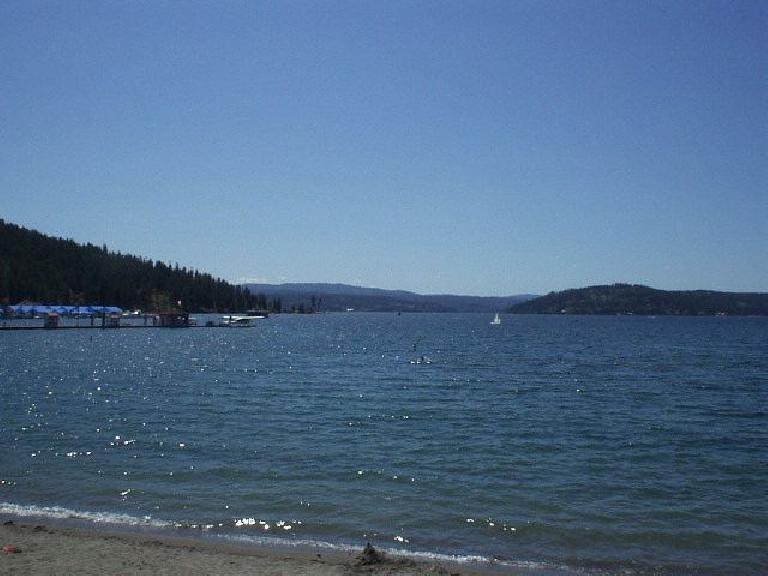 [Coeur d'Alene, Idaho] At last, almost 1100 miles from the San Francisco Bay Area, I make it to my destination.  This is the crystal-clear Lake Coeur d'Alene, viewed from the beach at the Coeur d'Alene resort. (June 27, 2003)