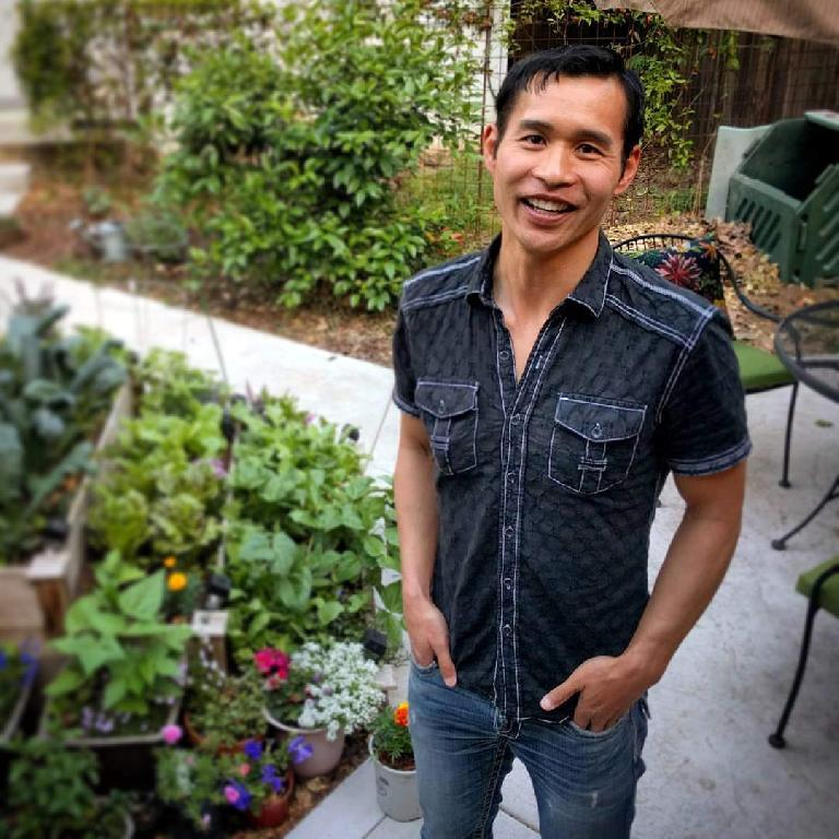Felix Wong in front of the garden at Stan's casita in Sacramento.