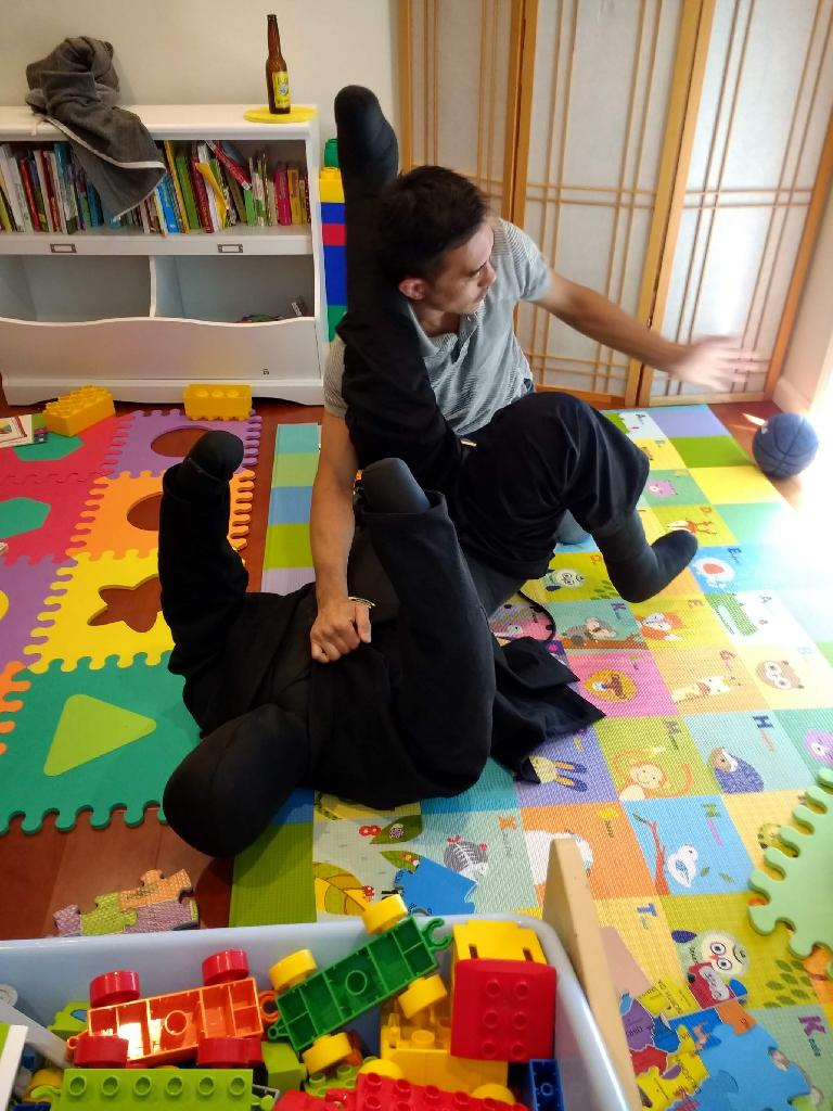 My cousin Konrad doing a jiu-jitsu move on the dummy.