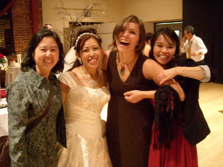Esther, Trang, Leah, and Nga at Trang's wedding reception.  Nga really liked Leah's toned arms.