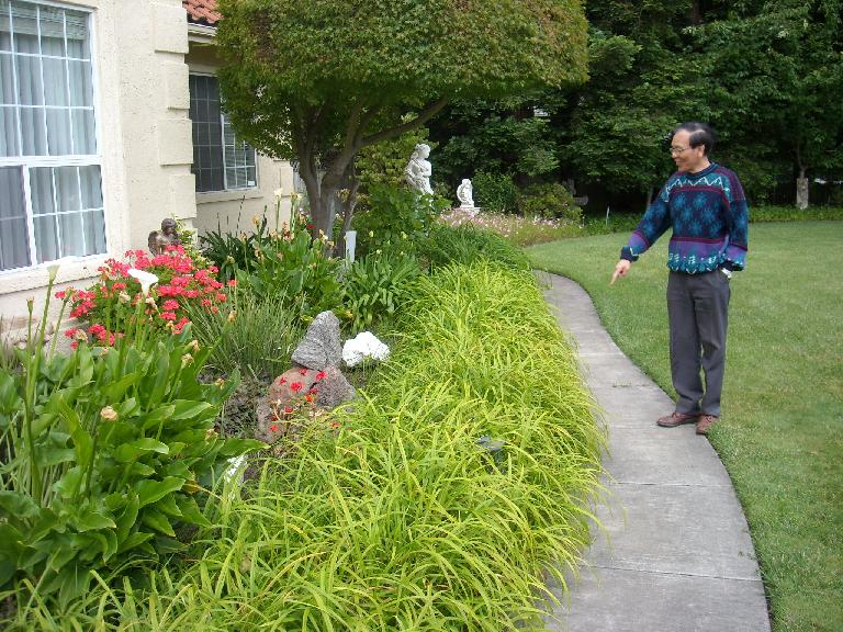 My dad pointing to something in his front yard. (June 5, 2011)