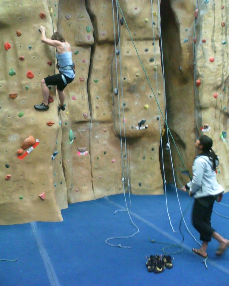 Leah climbing a 5.10 with Alyssa belaying.