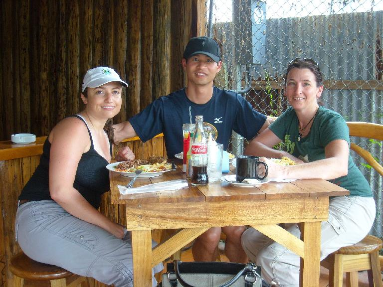 Raquel, Felix Wong and Tori at an outdoor Caribbean restaurant in town after a four-hour hike through the Cahuita National Park.