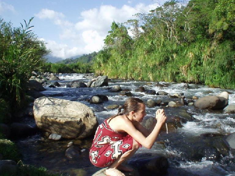 Andrea takes a photo with a splendid upstream view of the Caldera in the background.