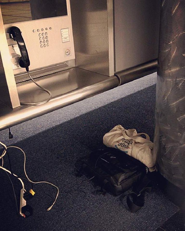 telephone booth, floor underneath, Denver International Airport
