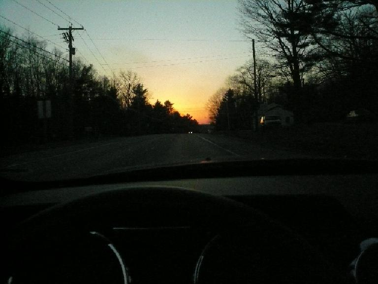 Driving back to Wiscasset, Maine towards an orange sunset.