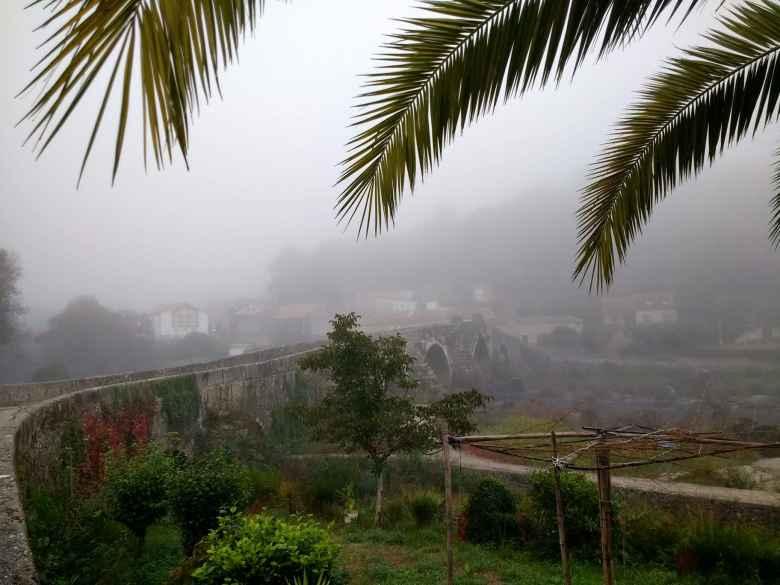 Fog over a bridge overlooking a river along the Camiño de Fisterra.