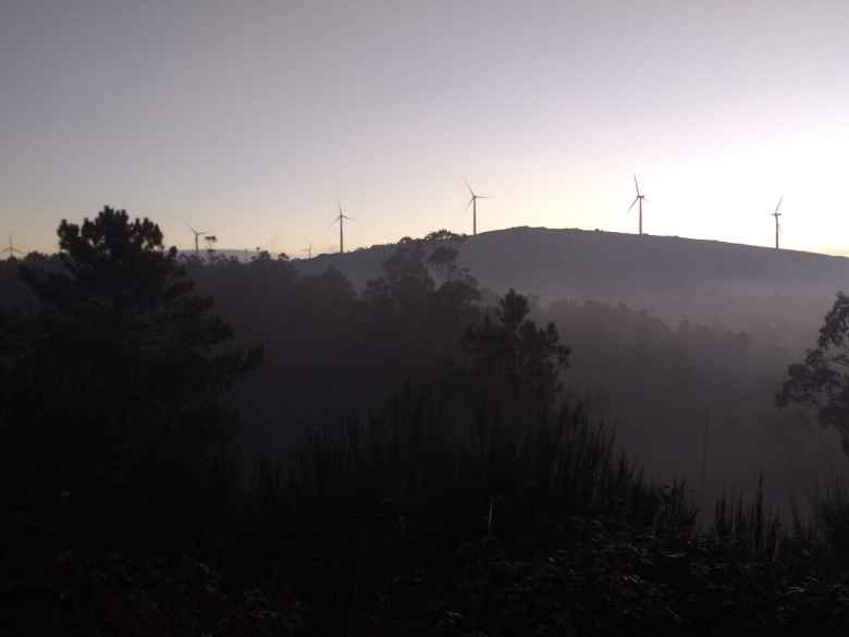 Windmills in the early morning as seen from the Camiño de Fisterra.