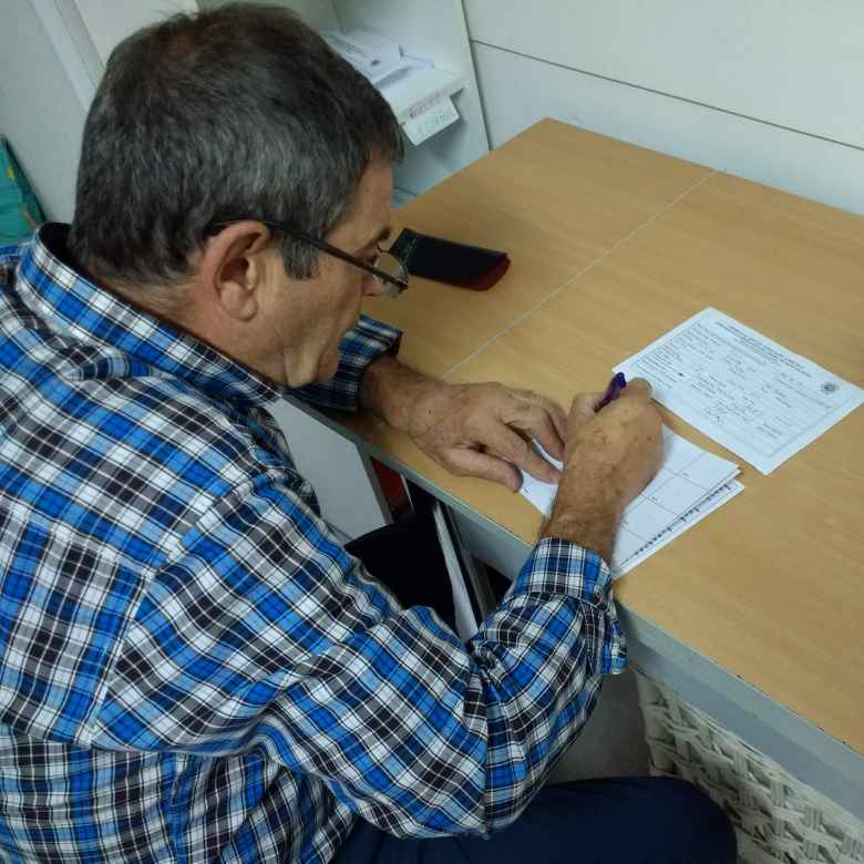 At the Albergue de Peregrinos in Irún, I picked up a pilgrim's passport (credencial in Spanish).  Here is a man running the albergue filling out the passport and giving me my first stamp.