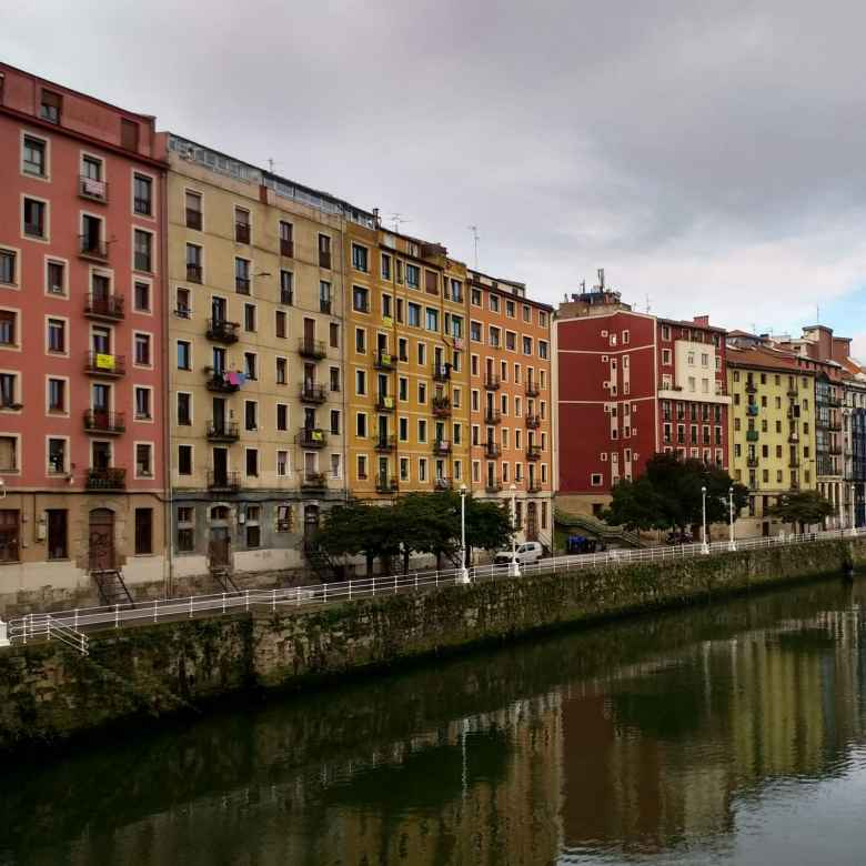 Colorful buildings by the Nervión River in Bilbao, Spain.