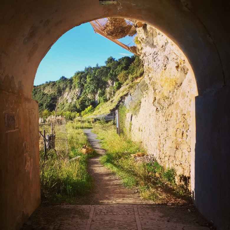 A trail and tunnel near Playa Ostende, Spain.