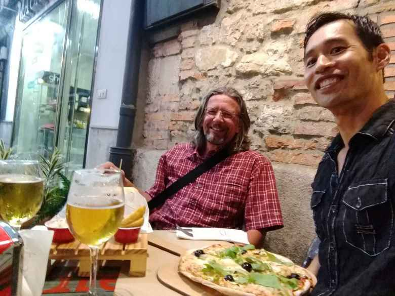 Thomas H. from Germany and Felix Wong at Fun & Food Ocio Gastronomico, for pizza and beer, in Santander, Spain.