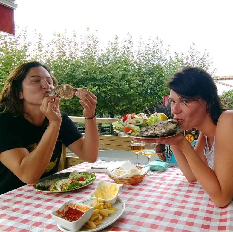 Jenny of Toronto and Teresa from Berlin eating fish at Bar Cañado in Còbreces, Spain. I met them across the street in Albergue Viejo Lucas.