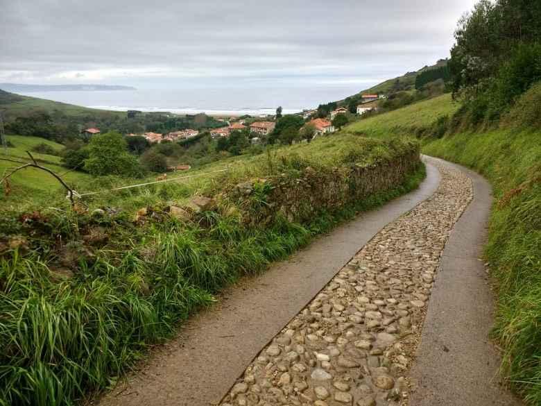 A semi-paved cobblestoned road in Vega, Spain.