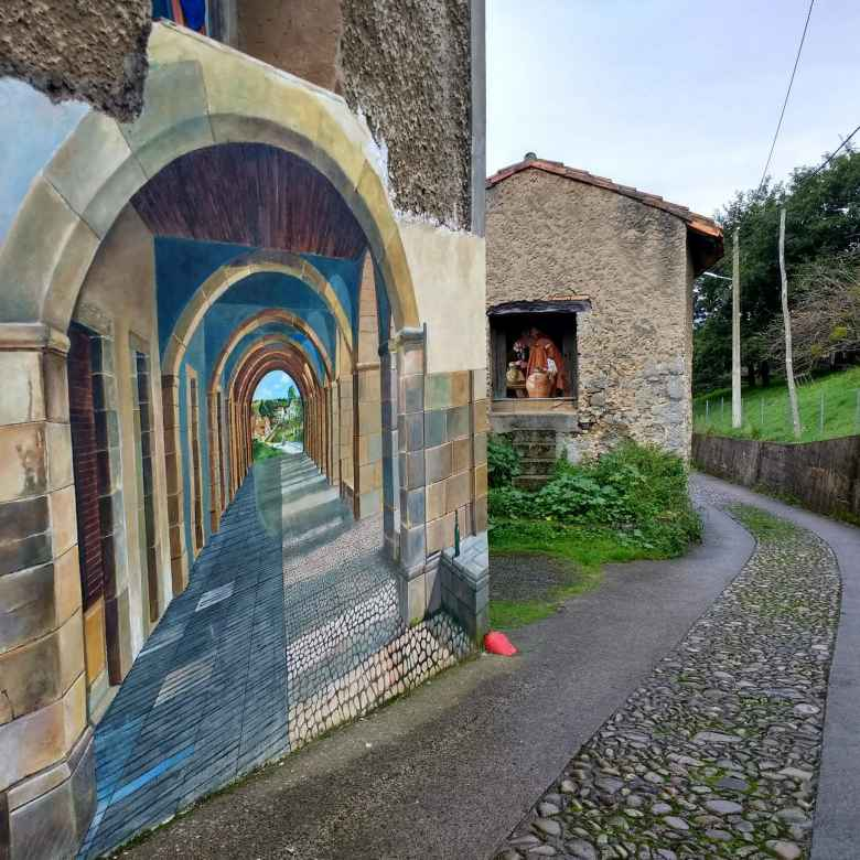 A beautiful mural of a path through an arched corridor along the Camino de Santiago del Norte.