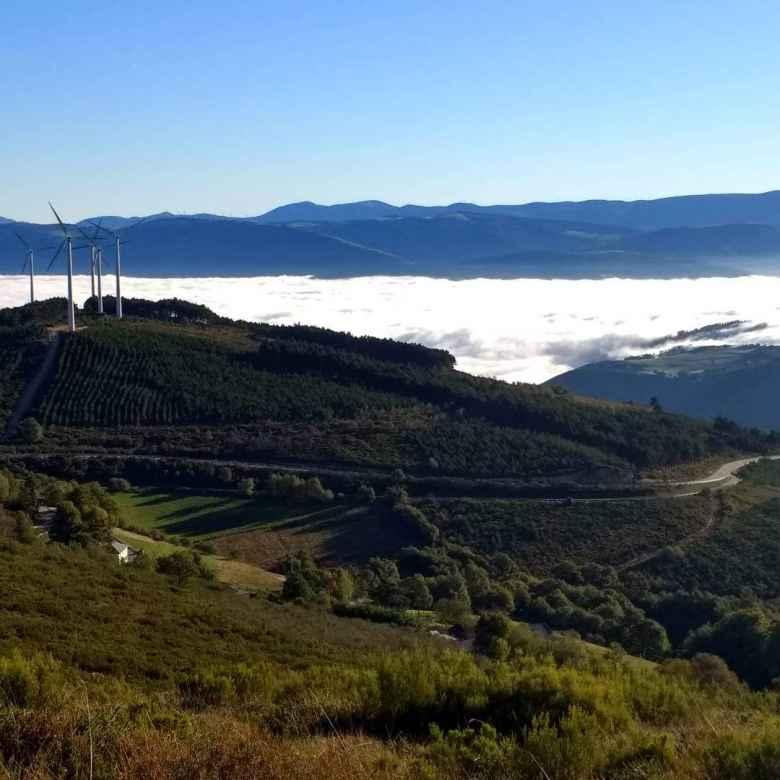 Windmills and fog in Bustelo del Camín, Spain.