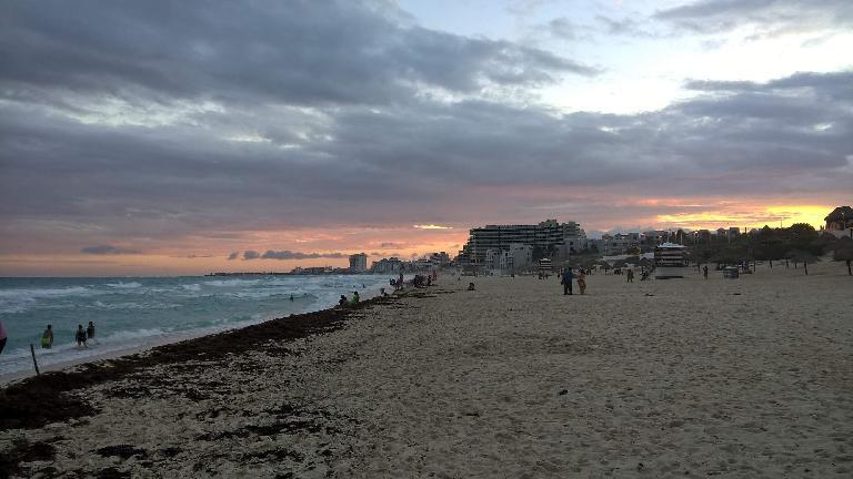 Cancun beach, sunset, sand, ocean waves