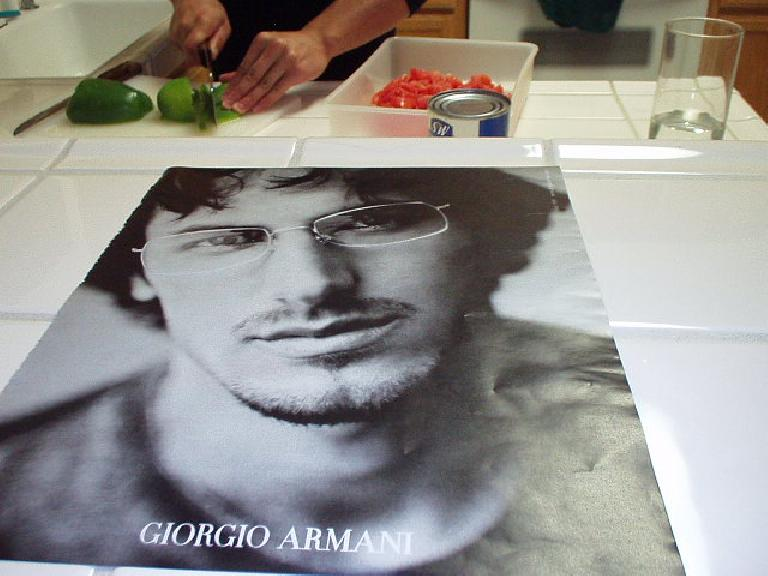 ...but Carolyn seemed to be more impressed by Ethan, winner of Survivor III, in this Giorgio Armani ad instead, for some reason! (November 10, 2002)