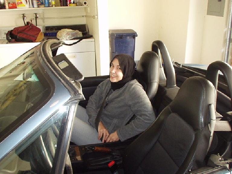 "Carolyn all bundled up as Felix's ""Muslim girl"" on the way to Stockton, top down and all. (November 11, 2002)"