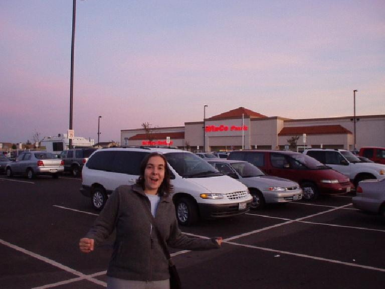 Carolyn in front of the new WinCo in Stockton, where one can buy 5 lbs of tortilla chips for like $2.50 (if one had the urge to eat 5 lbs. of tortilla chips for some reason...) (November 11, 2002)