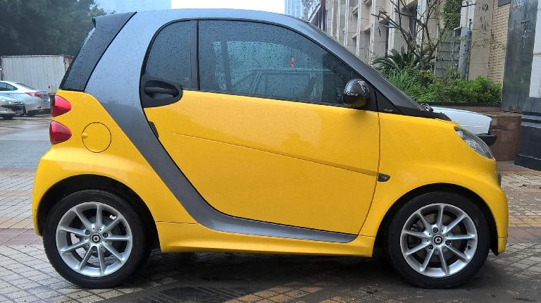 A yellow Smart Fortwo in Xiamen, China. (April 15, 2016)