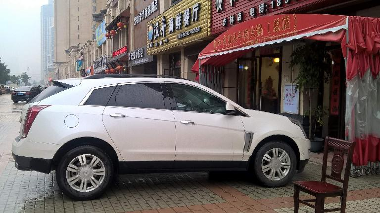 Pink Cadillac SRX in Xiamen, China. (April 15, 2016)
