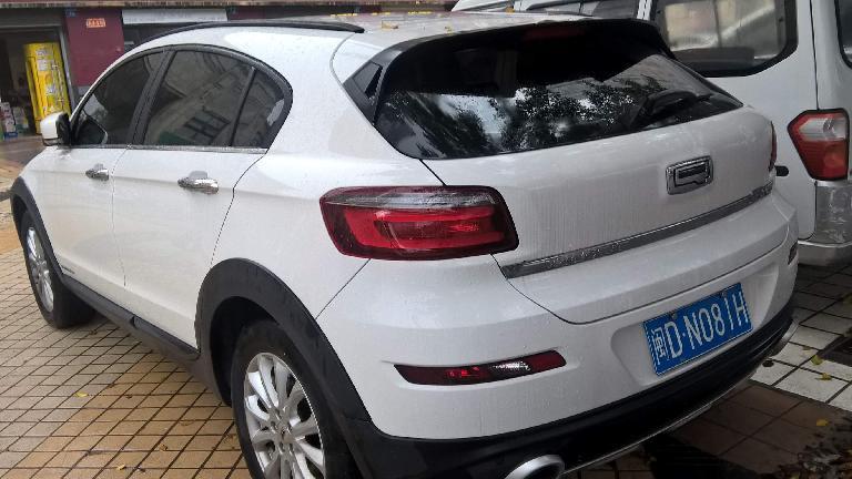 white Qoros 3 hatchback