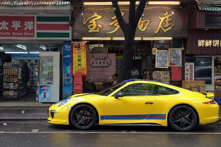 A yellow Porsche 911 with red and blue stripes. (April 22, 2016)