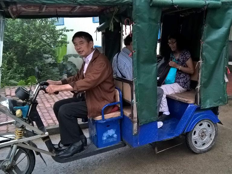My parents and I were driven by a driver of a 3-wheel electric trike to Shawanzhen from Shatou Residential District, China. (April 23, 2016)