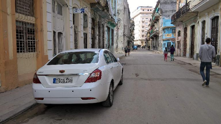 A newish white Geeley EC7 sedan in Havana, Cuba.